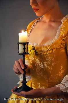 Trevillion Images - woman-in-historical-dress-with-candle