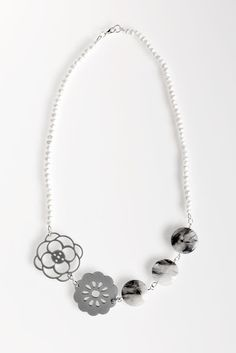 Pearl and Silver Acrylic Flower Necklace- Silver coloured acrylic flowers are strung together with genuine rutilated quartz beads and freshwater pearls. This asymmetrical necklace acts as a modern update to the classic strand of pearls. Single Pearl Necklace, Pearl Necklace Wedding, Mother Of Pearl Necklace, Cultured Pearl Necklace, Pearl Pendant Necklace, Freshwater Pearl Necklaces, Flower Necklace, Loc Jewelry, Star Jewelry