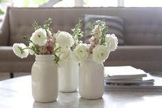 three vase bouquet of ranunculus