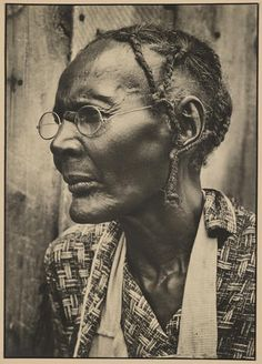 Margaret Bourke-White (1904-1971) Sharecropper, 1936 Warm-toned gelatin silver print, with black borders, mounted; her 'A Margaret Bourke-White Photograph' credit stamp on the mount verso.