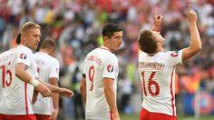 Jakub Błaszczykowski (R) of Poland celebrates after scoring the opening goal during their UEFA EURO 2016 Group C match against Ukraine