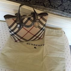 Burberry bag Like new. Classic Burberry bag. Purchased at Bloomingdale's. A little wear around the top (as seen in the picture) other wise perfect.  A new Burberry bag is at least $1000 now. Burberry Bags Totes