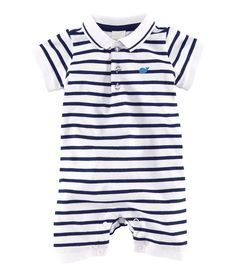 Piqué bodysuit with a collar and buttons at the top, a small print at the front, short sleeves and short legs. Press-studs at the crotch.  Available sizes: 0-6M.  5% elastane, 95% organic cotton.  NRs 1,550.