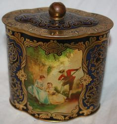 Vintage August Storck Victorian Style Scene Blue & Gold Germany Candy Tin. I bought this tin for my precious Grandmother for Christmas of 1960, When she passed my aunt gave it back to me. Kat