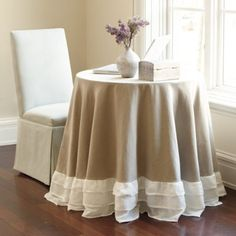 "Is it okay to love a tablecloth? French for ""ruffle,"" the ruches are sewn in a triple hem of sheer linen for natural contrasting texture. Center is natural linen/cotton blend and lined to enhance the flowing drape. Ballard."