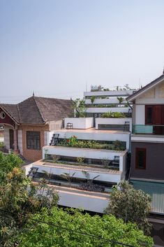 Image 1 of 36 from gallery of Terraces Home / H&P Architects. Photograph by Nguyen Tien Thanh