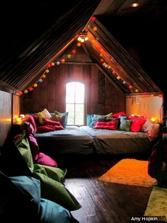 I love attic bedrooms. Those slanted walls give it that closed in cozy feeling I love.
