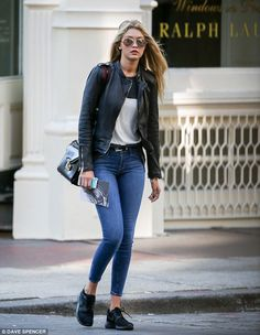 Casual stroll: Gigi Hadid strutted through Manhattan Wednesday in skinny jeans and a black leather jacket