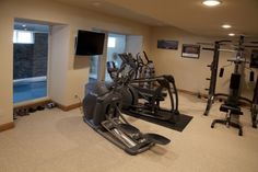 Indoor pool addition with sun room and patio over the pool traditional home gym