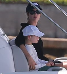 Ivanka Trump models a plunging black swimsuit as she soaks up the sun on a boat in Miami with family   Daily Mail Online Donald Trump Daughter, Trump Models, Jared Kushner, First Daughter, Ivanka Trump, Black Swimsuit, Baby Strollers, Sons, Miami