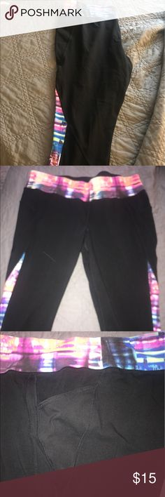 Lane Bryant Livi Active Workout Capris Rainbow colored tie-dye band and strips at the bottom of these cute workout pants! I am 5'6 and they fall at Capri length, halfway below the knee and above the ankle. They also have two pockets on either side for storage. Lane Bryant Pants Capris