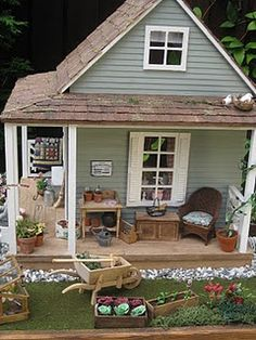 cute little miniature cottage, she has other dollhouses too that are awesome