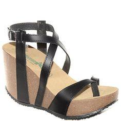 #Zeppa infradito alta in sughero e pelle nera con cinturino alla caviglia.