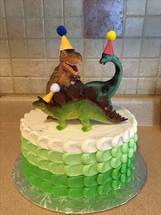 Dinosaur cake - love the party hats on the dinosaurs! Fourth Birthday, 4th Birthday Parties, Birthday Fun, Birthday Ideas, Dinosaur Birthday Cakes, Dinosaur Cake, Dinosaur Party Foods, Dinosaur Food, Fete Laurent