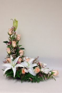 L-shaped flower arrangement. Perfect for a console or altar.