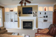 fireplace with hearth center bookcases on sides | entertainment ...