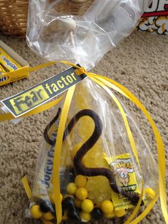 Yellow and black candy for goody bags with a black snake inside.