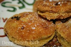 Southern Fried Green Tomatoes. Sliced green tomatoes, seasoned with salt, pepper, marinated in buttermilk, and dredged in a cornmeal and flour mixture tossed with Cajun seasoning, then fried. True Southern Classic!