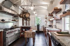 rustic industrial kitchen farmhouse with butcher block island pebble rock multiuse tiles