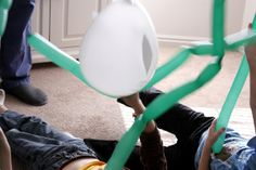 We also tried playing this seaweed balloon game. The object was to keep a balloon shark afloat with green seaweed balloons {balloon animal kind}. It turned into a wild balloon wrestling match. :)