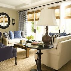 living rooms - navy wingback chair, navy blue wingback chair, face to face sofas, sofas facing each other, layered window treatments,  blue ...