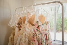 Floral bridesmaid dresses via Naomi & Caleb's Relaxed Country Wedding / LANE (PS Follow us on instagram: the_lane)