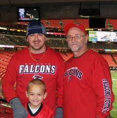 """The boys at the Falcons home game """"Rise Up!"""""""