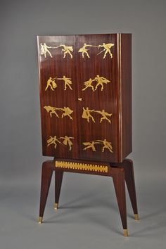 Bar-n Antonio Cassi Ramelli (1905-1980)  Italy (Milan), ca. 1940  Walnut cabinet with brass inlay, depicting eight pairs of fencers.