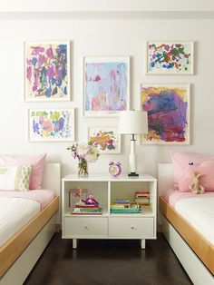 shared nightstand with two drawers and two shelves in girls shared room. girls art too.