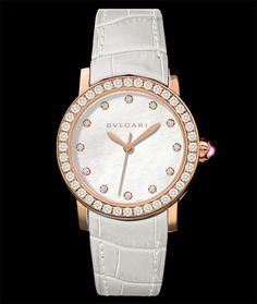 Bulgari Bulgari-Bulgari, 18 karat rose gold, diamond bezel, on alligator leather strap. Available at Cellini Jewelers