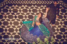 Sangeet Lehengas - Dev & Tarisha | WedMeGood | Bride in a Blue Lehenga with Silver Embroidery and an Aqua colored Net Dupatta #lehenga #indianbride #indianwedding #lehenga #blue #coupleshot #twirling