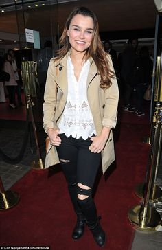 Keeping it casual: She paired ripped black jeans with boots and a light camel-coloured coa...