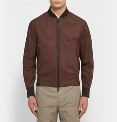 Berluti's bomber jacket is cut from the smoothest chocolate-brown nubuck. It's spliced with clever perforated panels at the underarms for ventilation and is finished with tactile ribbed trims. Left unlined to enhance its sharp profile, it will work equally well with off-duty and casual office looks.