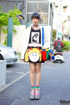 19-year-old Elleanor on the street in #Harajuku with rainbow hair, a Circus Harajuku t-shirt, a Jenny Fax Cabbage Patch skirt, colorful socks and #K3coltd platform sandals. Her FB page is #Elleanor's #Tokyo! #tokyofashion   #street  snaps