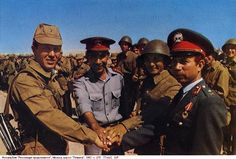 Soviet officers having a last greeting with Afghan police officers, 1988.