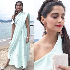 Cannes 2017: Sonam Kapoor makes a quirky statement in this pastel Masaba dhoti saree but we are digging the hairdo more – view… #FansnStars