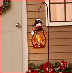Holiday Solar Snowman Lantern Stake - http://www.christmasshack.com/outdoor-christmas-decorations/holiday-solar-snowman-lantern-stake/