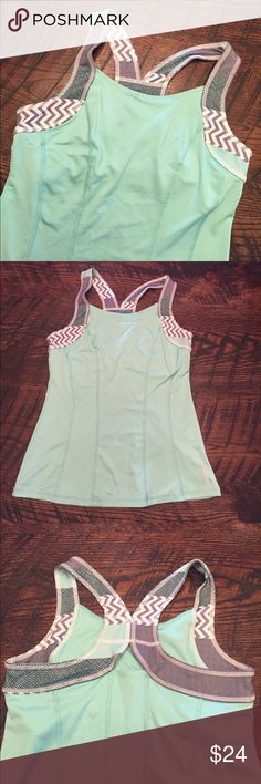 Women's Reebok tank Great workout tank with built-in bra! Size M. VERY gently worn and in like-new condition! Color is a light mint/turquoise color. Reebok Tops Tank Tops