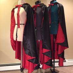 A trio of hooded cloaks