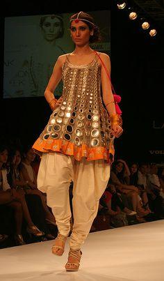 pair of dhoti pants set off a bright mirrored kurti