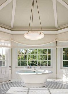 A way to have pretty roman shades that stay curved and to be able to have functioning shades behind