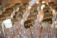 REINVENTING ESCORT CARD DISPLAYS | Intertwined Events | Barnet Photography | mirrored champagne stirrers