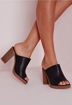 We've fallen head over heels for this pair of stunning heels. The mule is making a come back and we're lusting over the super chic black tone finish. This simple style is oh so chic finishing with a faux leather finish creating a super comf...