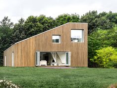 """12 Homes Made From Shipping Containers: Copenhagen-based architecture firm arcgency created the """"WFH House"""" in Wuxi, China, out of three stacked shipping containers. Upcycled steel shipping containers were used for a steel frame, which was then clad with a sustainable bamboo facade"""