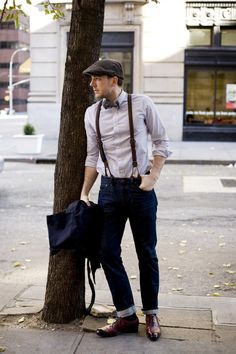 Great Depression NYC Era look—Vintage leather braided braces. Jeans by JBrand (Dylan, 34). Grey chambray shirt by MAB (custom made). Trench by Brooks Brothers Black Fleece (size 2). Tweed Ivy cap by JCrew. Vintage wool glenplaid bow tie. Oxblood lace-up shoes by Scarpe di Bianco.
