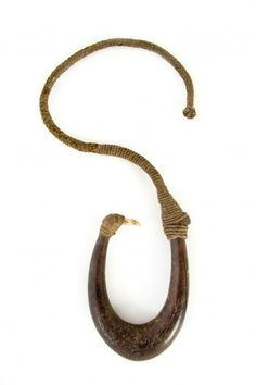 Large matau-fishing hook, a composite fish hook of gigantic proportions fashioned from a native hardwood sapling. a robust length of cord (aho) is attached to the top. the small barb is fasioned from a mammal's tooth and has two serrated points to each side. It has been attached to the shank with muka (flax fibre) cord Hardwood bone plant fibre. New Zealand Maori