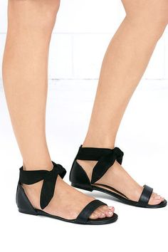 We can't help but make eyes at the Flirtatious Behavior Black Ankle Wrap Flat Sandals! Black vegan leather covers a slender toe strap and sturdy heel cup with tying vegan suede ankle strap.