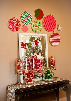 Apothecary jars filled with vintage glass balls ~ holiday fabric embroidery hoops ~ love!