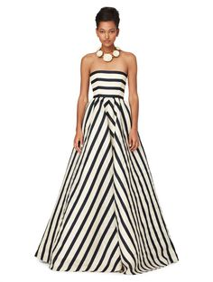 I have never wanted an article of clothing more than this Oscar de la Renta black and white striped gown. Six thousand dollars is doable, right??