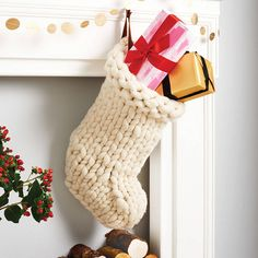 Chunky Hand Knitted Christmas Stocking. A festive christmas stocking hand knitted using beautifully soft and cosy Merino wool. This decorative Christmas stocking will make the perfect addition to any home this christmas and for many years afterwards.